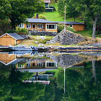 Europe, Norway, Stavanger. Home, boathouse and reflection on Lysefjord.