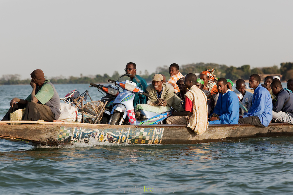Passengers on a long boat cross the Niger River early in the morning at Segou, Mali