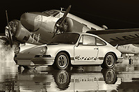 A Porsche Carrera is one of the rarest of the rare - and very impressive cars in the world. It is one of the original Black editions of the Porsche cars, and it is one of the most unique and well-preserved original  editions that the company has created. This Black and white photo of a Porsche 911 Carrera shows the exterior of the car in its best possible light. The images show off the full length, flat front hood, the sleek black finish, full bumper, and the classblack-kidneyney bean and chrome emblems. This exclusive Black and white photo of a Porsche 911 Carrera is truly remarkable, and it's something that you will be able to cherish for many years to come!