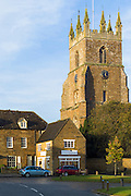 The traditional Cotswold village of Deddington and church of St Peter and St Paul in The Cotswolds, Oxfordshire, UK