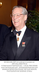 SIR MICHAEL BETT at a dinner in London on 30th May 2002.PAN 8