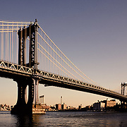Late afternoon light on. the Manhattan Bridge which joins the boroughs of Manhattan and Brooklyn crossing the East River.