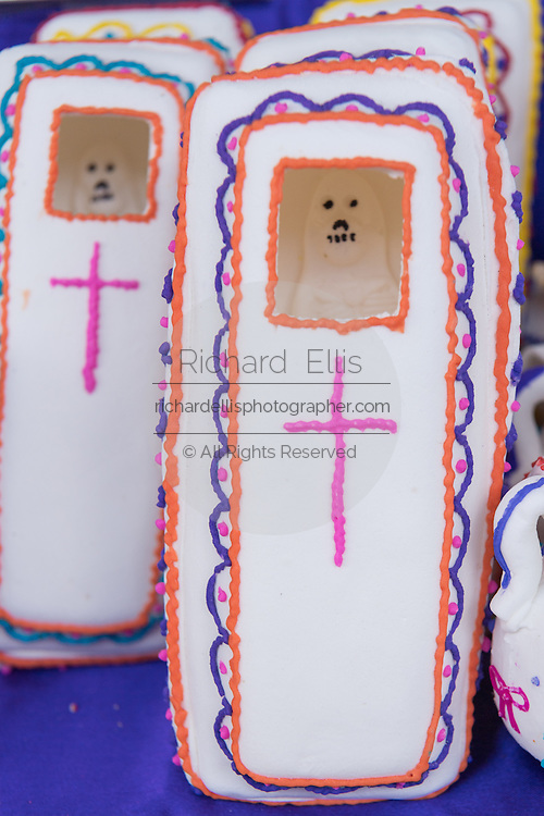 Decorated folk art sugar coffins representing departed soul on sale at a street market in preparation for the Day of the Dead festival October 26, 2016 in Comonfort, Guanajuato, Mexico. The celebration is a time when Mexicans welcome the dead back to earth for a visit and celebrate life.