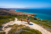 Hiker enjoying the view from the Torrey Pines Trail, Santa Rosa Island, Channel Islands National Park, California USA