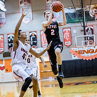 Gallup Bengal Ronald Perry (45), guards Aztec Tiger Jake Feil (2) as he elevates in the paint at Gallup High School Friday.