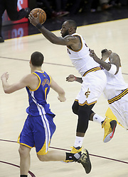 June 9, 2017 - Cleveland, OH, USA - The Cleveland Cavaliers' LeBron James, middle, steals a fast break pass in front of the Golden State Warriors' Klay Thompson during the fourth quarter during Game 4 of the NBA Finals at Quicken Loans Arena in Cleveland on Friday, June 9, 2017. The Cavs won, 137-116, trimming their series deficit to 3-1. (Credit Image: © Phil Masturzo/TNS via ZUMA Wire)