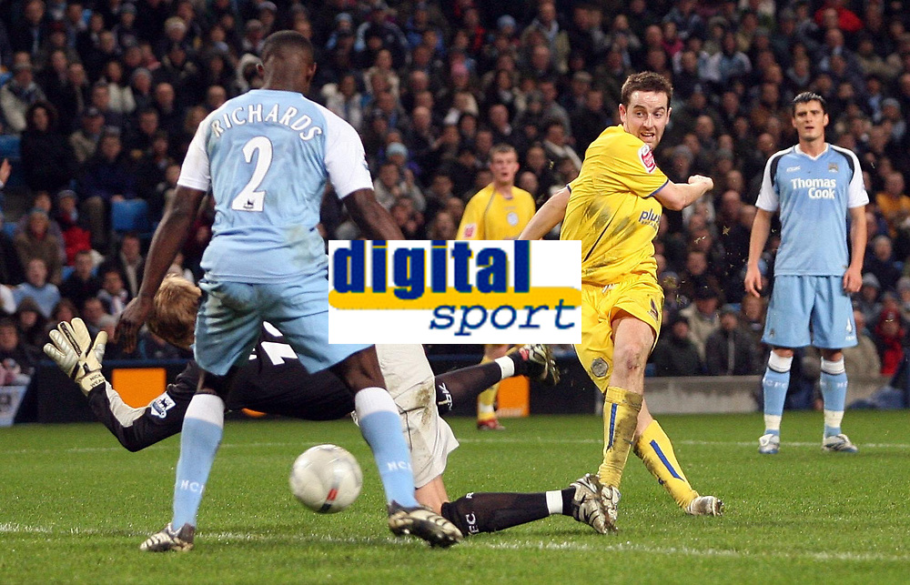 Photo: Paul Thomas.<br /> Manchester City v Sheffield Wednesday. The FA Cup. 16/01/2007.<br /> <br /> Steve MacLean (R) of Wednesday has this shot double blocked by Man City keeper Nicky Weaver and Micah Richards (2).