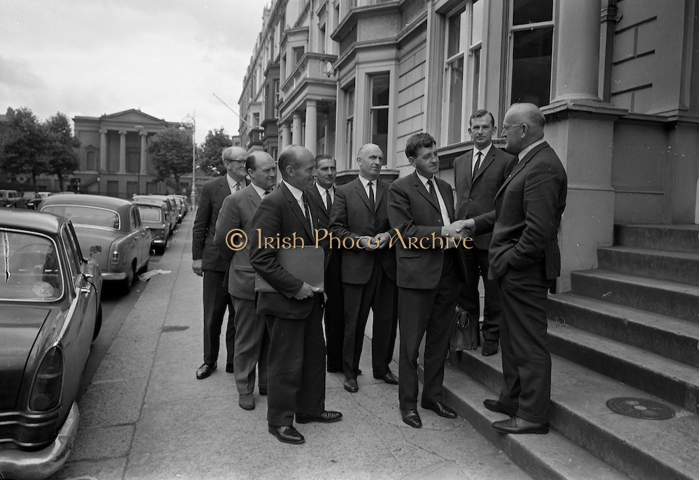 """20/07/1967<br /> 07/20/1967<br /> 20 July 1967 <br /> Ulster Farmers Union meet National Farmers Association at N.F.A. House, Dublin. Six members of the Ulster Farmers Union led by their President Mr Pat Byrne had a meeting with the N.F.A., where they discussed the position of the livestock trade and what steps might be taken to avoid """"a crisis later this year, similar to what happened last year"""". Also discussed was the implications of membership of the Common Market. Picture shows Mr Pat Byrne, President U.F.U. being greeted by Mr Richard Deasy, President N.F.A. with Mr Brendan Power Acting General Secretary N.F.A. in the centre and the other members of the U.F.U who included, Mr James Jordan, Deputy President U.F.U.; Mr. James T. O'Brien, General secretary U.F.U.; Mr Tom Orr, Junior Deputy President; Mr. F.M.B. Loane, Secretary Livestock Committee U.F.U. and Mr. A. McLurg, Livestock Committee U.F.U. outside N.F.A. House."""
