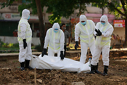 People, wearing protective suits, carry the body of Jalal Saifur Rahman who died due to coronavirus disease (COVID-19), before his burial at a graveyard in Dhaka, Bangladesh, April 6, 2020. Jalal Saifur Rahman, a director of Bangladesh government's main anti-graft body died due to coronavirus on Monday morning in the capital Dhaka. Jalal Saifur Rahman, was admitted to a hospital after having tested positive for coronavirus one week ago. Photo by Suvra Kanti Das/ABACAPRESS.COM