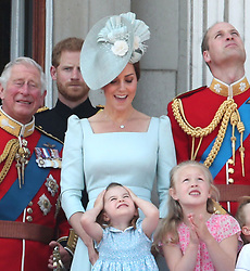 (Left to right) The Duke of Wales, Duke of Sussex, Duchess of Cambridge holding Princess Charlotte and Duke of Cambridge with Savannah Phillips on the balcony of Buckingham Palace, in central London, following the Trooping the Colour ceremony at Horse Guards Parade, as the Queen celebrates her official birthday.