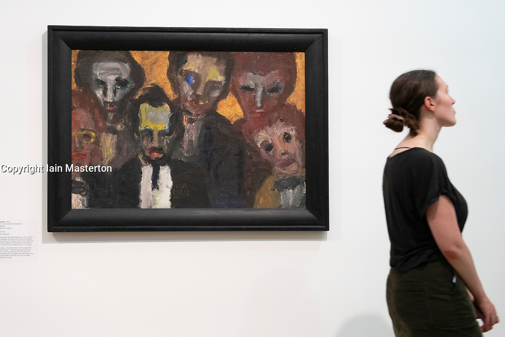 Painting Sechs Herren ( Six Gentlemen) by Emile Nolde at Hamburger Bahnhof in Berlin, Germany .Editorial Use Only.