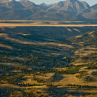 Meadows and grazing lands stretch below Montana's rugged and seldom-visited Crazy Mountains.