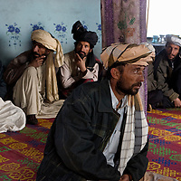 Afghan elders sit down to a mini Shura with US Forces at the onset of Operation Winterstand, a Humanitarian Assitance mission, part of the COIN (counter insurgency) program being actioned in Rebat, Pakitika Province, Afghanistan on the 19th of January 2008