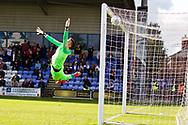 Macclesfield Town goalkeeper Owen Evans attempts to save the goal from Crawley Town forward Beryly Lubala (not in the picture) during the EFL Sky Bet League 2 match between Macclesfield Town and Crawley Town at Moss Rose, Macclesfield, United Kingdom on 7 September 2019.
