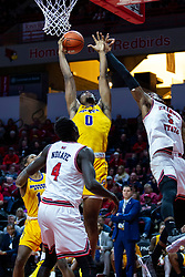 NORMAL, IL - December 07: Tyzhaun Claude grabs a rebound as Keith Fisher III sails past during a college basketball game between the ISU Redbirds and the Morehead State Eagles on December 07 2019 at Redbird Arena in Normal, IL. (Photo by Alan Look)