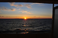Sunset on the Rybinsk Reservoir. The Volga-Baltic Waterway, made up of natural lakes, rivers, reservoirs, and canals, runs from St. Petersburg to Moscow, Russia, a journey of 700 miles.