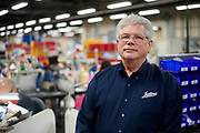 Ken Sprabeary poses for a portrait inside the Josten's factory in Denton, Texas on December 12, 2017. (Cooper Neill for The New York Times)