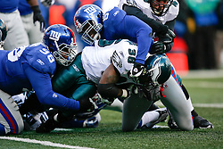 11 Jan 2009: Philadelphia Eagles running back Brian Westbrook #36 is tackled by New York Giants defensive tackle Fred Robbins #98 and linebacker Danny Clark #55 during the game against the New York Giants on January 11th, 2009.  The  Eagles won 23-11 at Giants Stadium in East Rutherford, New Jersey. (Photo by Brian Garfinkel)