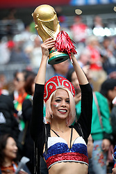 A Russia fan in the stands with a replica world cup trophy ahead of the FIFA World Cup 2018, Group A match at the Luzhniki Stadium, Moscow.