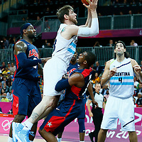 06 August 2012: Argentina Andres Nocioni goes for the jumpshot against Chris Paul during 126-97 Team USA victory over Team Argentina, during the men's basketball preliminary, at the Basketball Arena, in London, Great Britain.