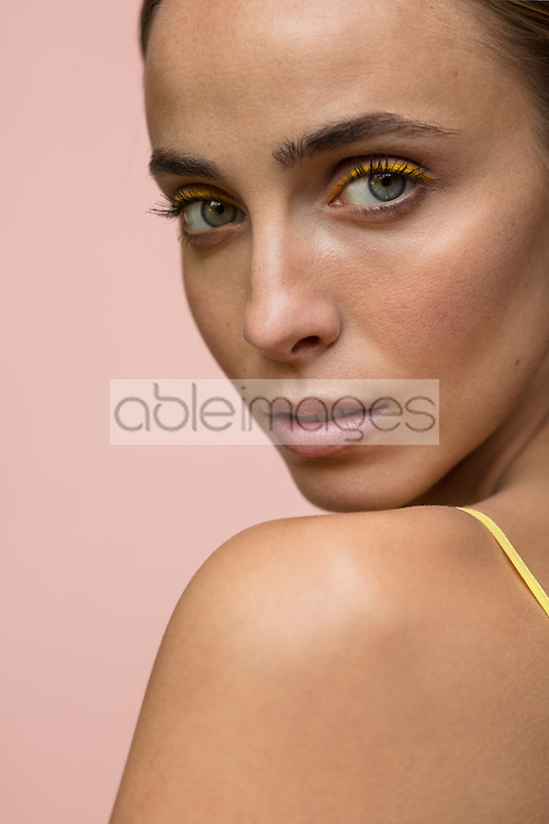 Beauty Portrait of Woman Looking over Shoulder, Close-up view