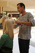 woman having her hair cut by male hair dresser