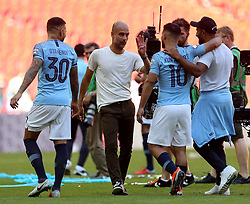 Manchester City manager Josep Guardiola with Sergio Aguero at full time