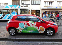 Germany, Freiburg  - November 22, 2018.Street scene with Electric Car and VAG tram (Credit Image: © Antonio Pisacreta/Ropi via ZUMA Press)