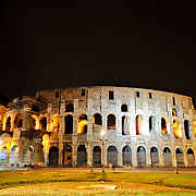 ROME, Italy - A night shot of the famous and historic Roman Coliseum in Rome, Italy, with lights.