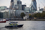 Thames River Police boat patrolling near to the City of London. Claimed to be England's oldest police force and was formed in 1798 to tackle theft and looting from ships anchored in the Pool of London and in the lower reaches and docks of the Thames.