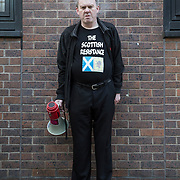 Sean Clerkin of the Scottish Resistance at a demo in Cadogan Street, Glasgow. Picture Robert Perry 29th Jan 2016<br /> <br /> Must credit photo to Robert Perry<br /> FEE PAYABLE FOR REPRO USE<br /> FEE PAYABLE FOR ALL INTERNET USE<br /> www.robertperry.co.uk<br /> NB -This image is not to be distributed without the prior consent of the copyright holder.<br /> in using this image you agree to abide by terms and conditions as stated in this caption.<br /> All monies payable to Robert Perry<br /> <br /> (PLEASE DO NOT REMOVE THIS CAPTION)<br /> This image is intended for Editorial use (e.g. news). Any commercial or promotional use requires additional clearance. <br /> Copyright 2014 All rights protected.<br /> first use only<br /> contact details<br /> Robert Perry     <br /> 07702 631 477<br /> robertperryphotos@gmail.com<br /> no internet usage without prior consent.         <br /> Robert Perry reserves the right to pursue unauthorised use of this image . If you violate my intellectual property you may be liable for  damages, loss of income, and profits you derive from the use of this image.