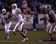 Florida Atlantic quarterback Sean Clayton (15) rolls outside against pressure from Kansas State nose tackle Steven Cline (99) in the second half, at Bill Snyder Family Stadium in Manhattan, Kansas, September 9, 2006.  The Wildcats beat the Owls 45-0.