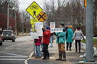 Sarah Thorne and Tom Howe are among dozens who came out Monday morning in support of the resignation of NH State Representative Dawn Johnson.  (Karen Bobotas Photo/for The Laconia Daily Sun)