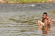 A boy plays in the river in San Esteban, Honduras on Thursday April 25, 2013.