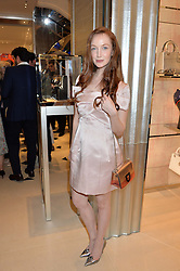 OLIVIA GRANT at a cocktail party to mark the opening of the House of Dior, the United Kingdom's largest and premier Dior boutique at 160-162 New Bond street, London on 8th June 2016.