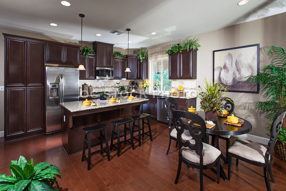 Kitchen and Dining Room with Hardwood Floors and Espresso Colored Cabinets
