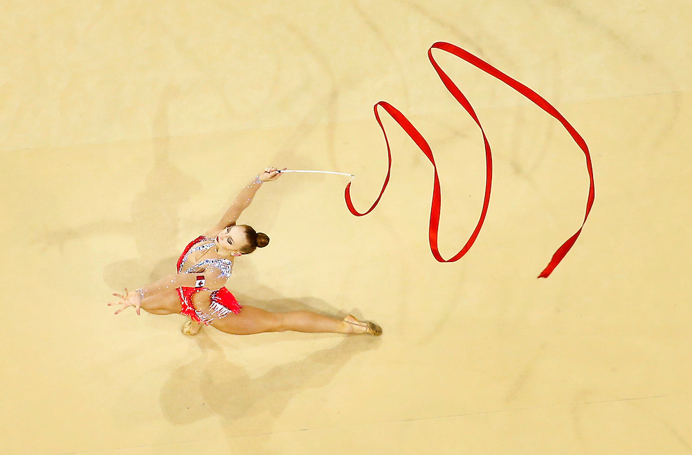 Canada's Patricia Bezzoubenko performs during the rhythmic gymnastics ribbon routine on her way to winning the bronze medal in the women's individual all-around at the Pan Am Games in Toronto, Saturday July 18, 2015.    THE CANADIAN PRESS/Mark Blinch