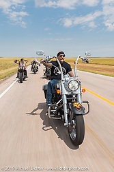 Reed Holmes, salesperson at Sun Harley-Davidson in Thornton, CO rides back to Sturgis after the annual Michael Lichter - Sugar Bear Ride hosted by Jay Allen with the Easyriders Saloon during the Sturgis Black Hills Motorcycle Rally. SD, USA. Sunday, August 3, 2014. Photography ©2014 Michael Lichter.
