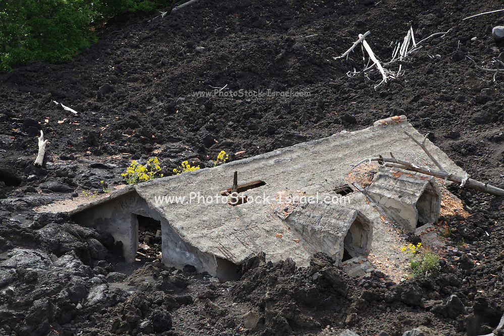Italy, Sicily, Etna volcano House partially covered by lava