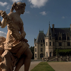 ASHEVILLE, NC-- A statue on the library terrace frames the Biltmore House.  Built and owned by the Vanderbilt family for over 100 years, it is one of Asheville's most popular tourist attractions.