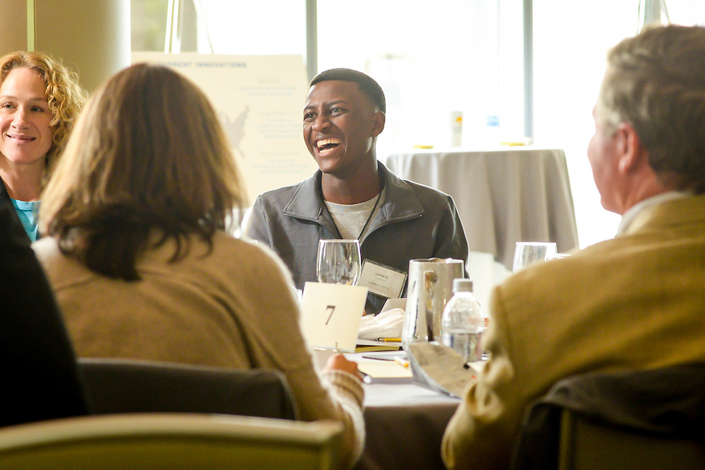 A student sits with Summer Search mentors over lunch in the Seaport Hotel's Lighthouse Room on South Boston's Waterfront.