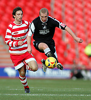 Photo: Paul Thomas.<br /> Doncaster Rovers v Swansea City. Coca Cola League 1. 17/02/2007.<br /> <br /> Ian Craney (R) of Swansea gets past Mark Wilson.