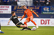 Luton Town player Andrew Shinnie is tackled in the box in the first half during the EFL Sky Bet League 1 match between Luton Town and AFC Wimbledon at Kenilworth Road, Luton, England on 23 April 2019.