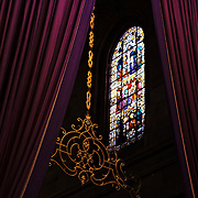 Window of Braga's Cathedral and the purple Easter decorations