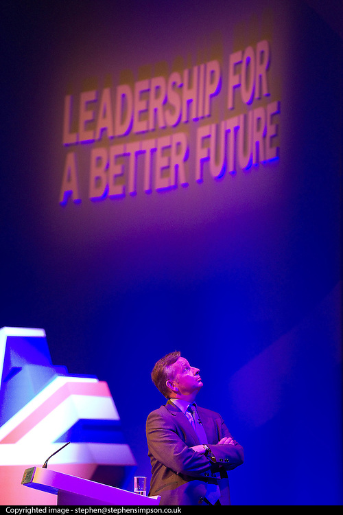 © Licensed to London News Pictures. 04/10/2011. Manchester, UK. Education Secretary, Michael Gove, looks up at the screen as the Prime Minister delivers a live address to the Conservative Party Conference in Manchester, from a nearby school. Photo credit : Joel Goodman/LNP