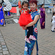 """China Britain Business women association hosts The 2nd China Britain Fashion Festival """"Qipao"""" The mainland Chinese and oversea born Chinese singing together (我和我的祖国)Me and my country. To celebration of Great China 70th China National Day 2019. A """"Chinese Qipao"""" Flash mob. The Chinese in 28 counties and cities across Britain participate in the thousands of cheongsams and end in London today on the 28 September 2019, UK."""