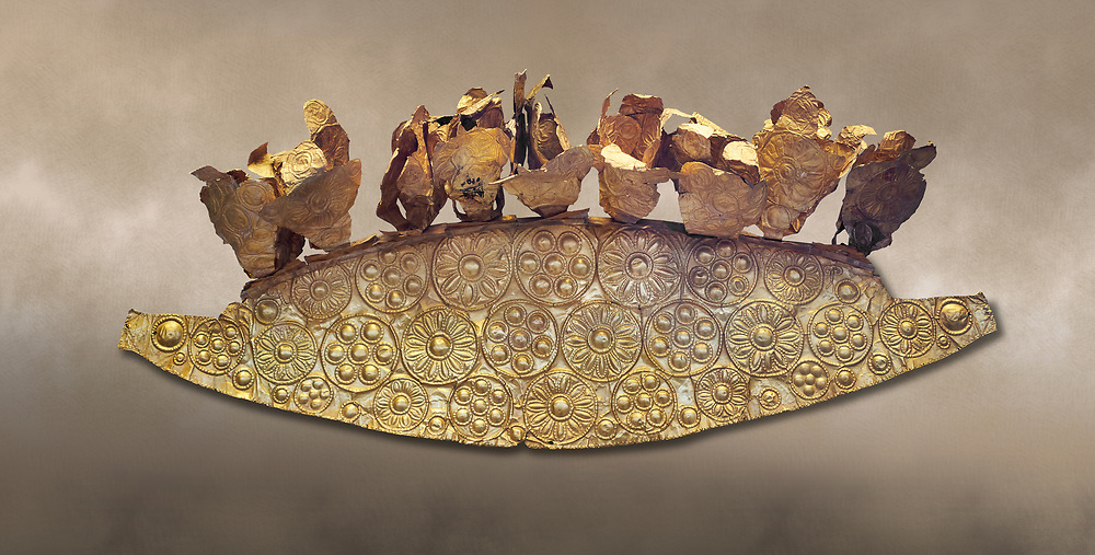 Mycenaean Gold diadem from Grave III, 'Grave of a Women', Grave Circle A, Myenae, Greece. National Archaeological Museum Athens.<br /> <br /> An impressive Mycenaean gold diadem with repousse rosettes and thin sheets applied to the top. .Cat No 1. 16th century BC.<br /> <br /> Shaft Grave III, the so-called 'Grave of the Women,' contained three female and two infant interments. The women were literally covered in gold jewelry and wore massive gold diadems, while the infants were overlaid with gold foil. .<br /> <br /> If you prefer to buy from our ALAMY PHOTO LIBRARY  Collection visit : https://www.alamy.com/portfolio/paul-williams-funkystock/mycenaean-art-artefacts.html . Type -   Athens    - into the LOWER SEARCH WITHIN GALLERY box. Refine search by adding background colour, place, museum etc<br /> <br /> Visit our MYCENAEN ART PHOTO COLLECTIONS for more photos to download  as wall art prints https://funkystock.photoshelter.com/gallery-collection/Pictures-Images-of-Ancient-Mycenaean-Art-Artefacts-Archaeology-Sites/C0000xRC5WLQcbhQ