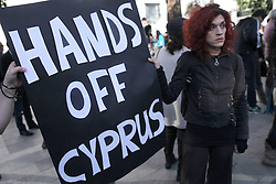 People protest outside the parliament holding banners shouting slogans and saying No to haircut in capital Nicosia, Cyprus, March 18, 2013. Photo by Imago / i-Images...UK ONLY.Contact..