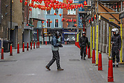 Three food delivery workers are seen looking for their Chinese food supply shop to pick up their deliveries in deserted China Town in London, Britain, on Sunday, May 3, 2020. (Photo/ Vudi Xhymshiti)