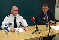 Chief Inspector Norman Haslett, PSNI commander for west Belfast (left) and Detective Chief Inspector Peter Montgomery who is leading the murder investigation into the death of Joe Reilly on Thursday, during a press conference in Belfast, as police have described his killing as a cold blooded execution.